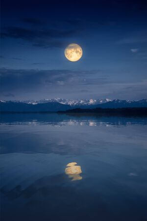 An image of the Starnberg Lake by night with full moon near Tutzing Bavaria Germany Banque d'images