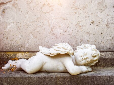 An image of a sleeping angel grave statue