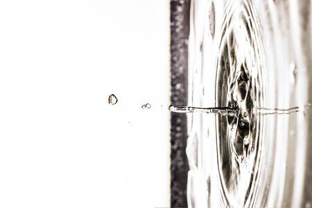 An image of a beautiful black water drop background tilt