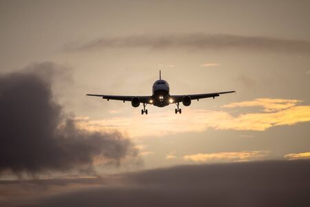 A photography of a jet air plane in sunset sky