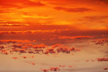 An image of a cloudy red sunset sky