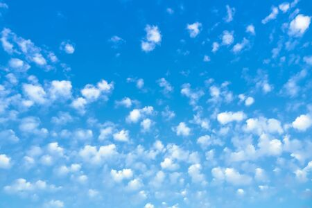 An image of a blue sky with lots of small clouds
