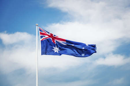 An image of the australian national flag in front of the sky