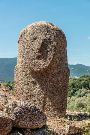 megaliths: Menhir with human face at Filitosa archeological site in Corsica island