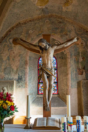 Cross with Jesus Christ in a small church in Germany