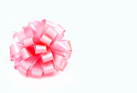 A pink ribbon bow on white background Stock Photo