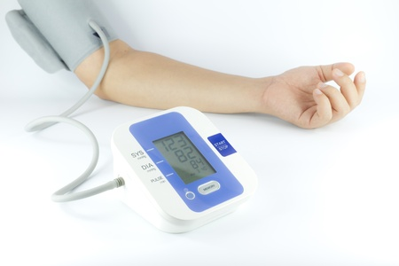 Man checking blood pressure isolated over white Stock Photo
