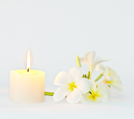 Aroma candle and Frangipani flower ,Calmness concept Stock Photo