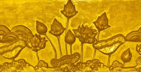 Golden lotus stucco Stock Photo