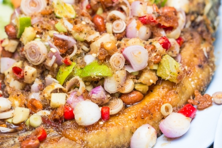 Fried fish with spicy salad photo