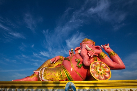 Pink Ganesha against with blue sky photo