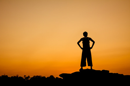 Silhouette of a man in relaxing posting photo
