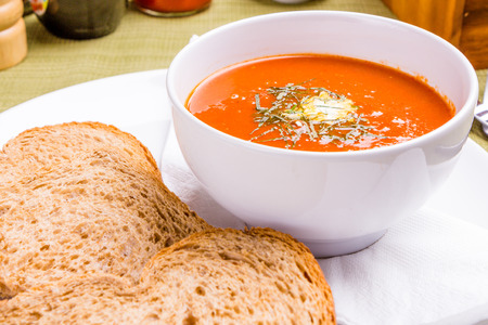 Tomato soup with bread Stock Photo
