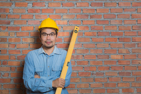 Asian construction technician with water gauge Stock Photo