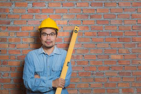 Asian construction technician with water gauge Reklamní fotografie