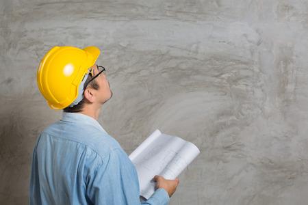Asian construction technician checking his work