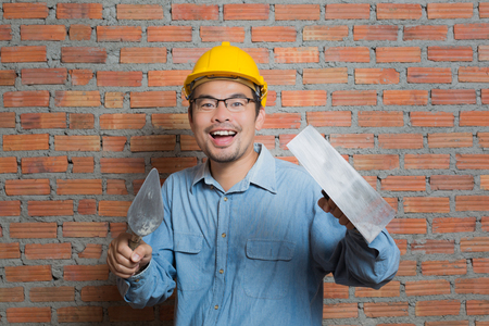 Asian construction technician with his tools