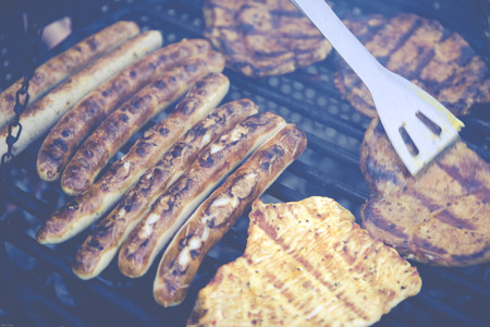 grill tongs sausage: BBQ grilled meat and beef Stock Photo
