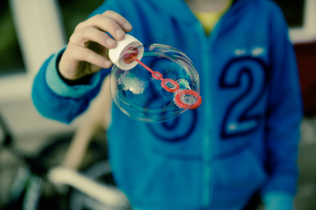 clear away: children play with soap bubble
