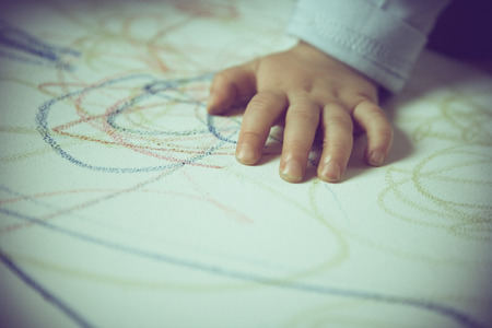 children play area: child draw with colored crayon