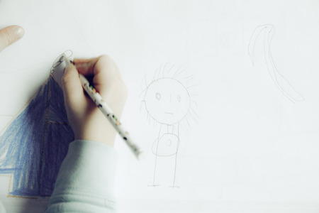 school nurse: child draw with colored pencil