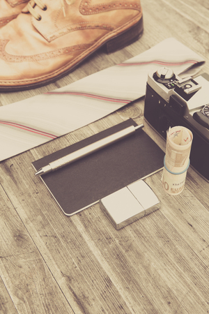 analog camera: neourban hipster fashion travel with items handemade leather shoes, analog camera, notebook, pen, lighter, tie
