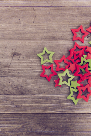 red green wooden christmas stars Standard-Bild