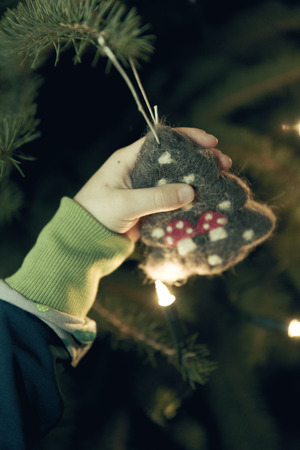 Hand holding Christmas vintage decoration