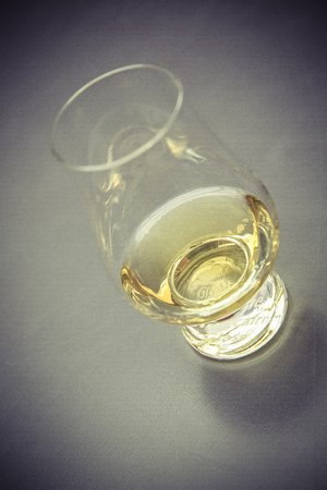 golden whiskey glass without ice cube