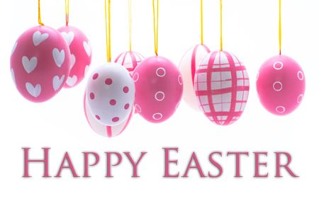easter decorations: Happy easter message with easter eggs hanging form above. Stock Photo
