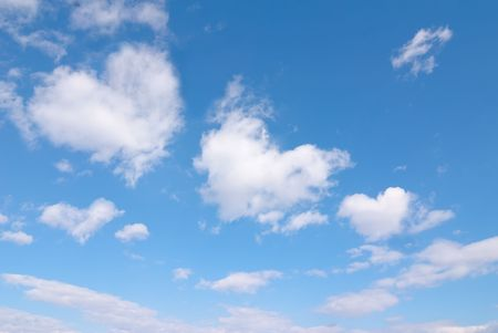 shaped: Beautiful blue sky with some romantic heart shaped clouds.
