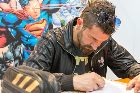 July 1st 2017. Stuttgart, Germany. Italian comic artist Pasquale Qualano (Torchwood) signing and drawing at Comic Con. Comic Con Stuttgart invites fans and cos-players to meet celebrities and comic artists in panels, Q&As, photo and signing sessions