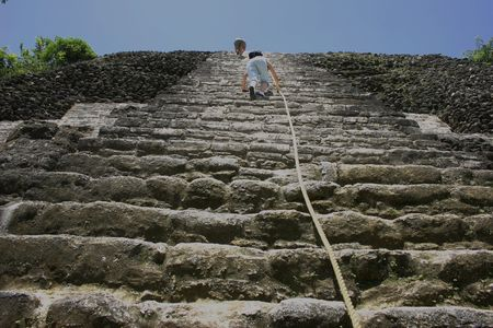 Figure Climbing a Pyramid Zdjęcie Seryjne - 4032811