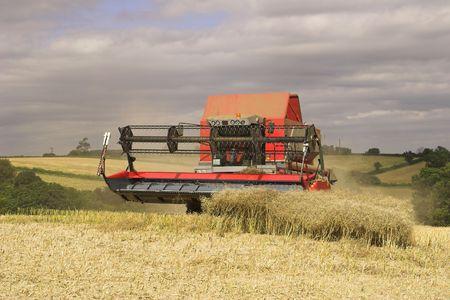 Combine harvester on Woodborough Park Farm, Woodborough, Nottingham, England, U.K.