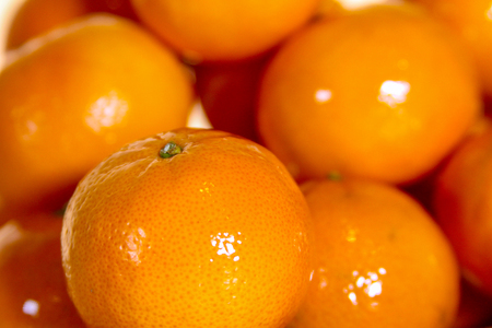 Fresh and Clean Madarin Oranges focused in on the front Orange leaving the other Oranges in a soft Focus.