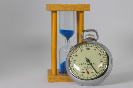 Vintage Stop-Watch and Hour-Glass with Time Passing Stock Photo