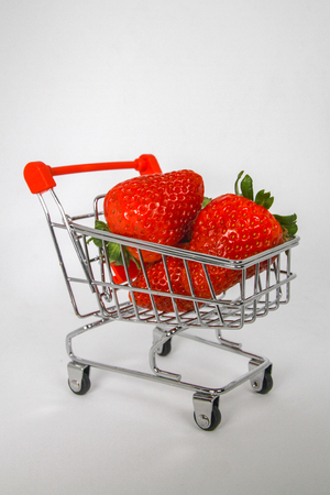 Strawberries in a Miniature shopping Cart