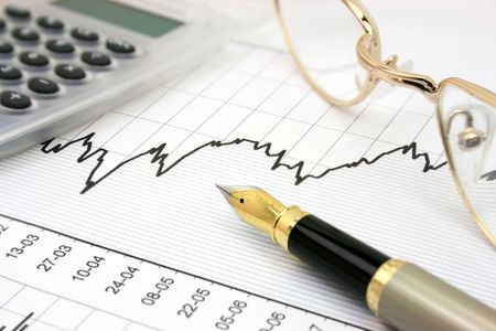 Stock chart with calculator, fountain pen and eyeglasses Stock Photo - 918841