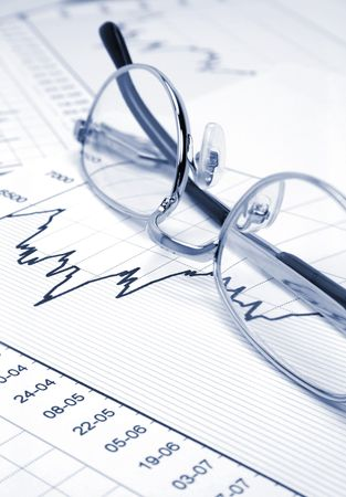 Stock chart and eyeglasses (blue toned) photo