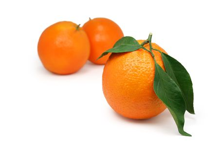 organically: Organically grown oranges with leaves Stock Photo