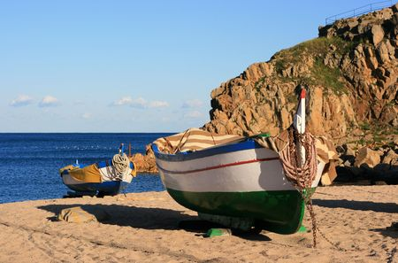 costa brava: Old colorful fishing boats moored on the beach (Blanes - Costa Brava, Spain) Stock Photo
