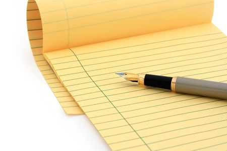 Legal pad and fountain pen on white (clipping path included) photo