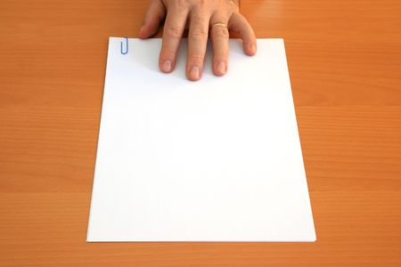 Male hand presents a blank document photo
