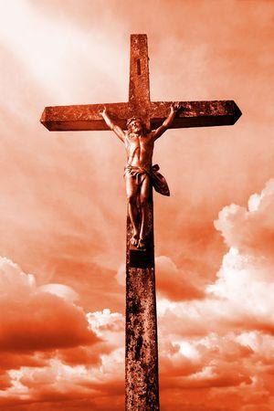 rood: Jesus on the cross over dramatic sky (orange toned)