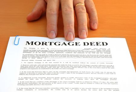 Male hand presents a mortgage document Stock Photo - 2667434
