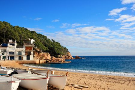 Boats on the beach at Tamariu (Costa Brava, Catalonia, Spain) photo