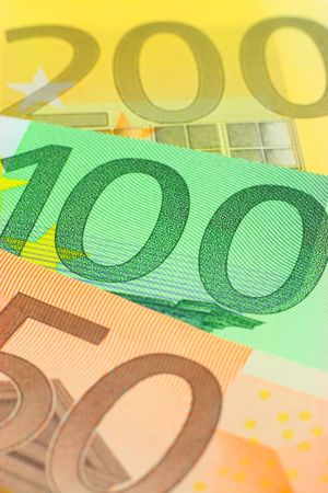 Three euro notes closeup. Shallow depth of field, focus on 100 note) photo