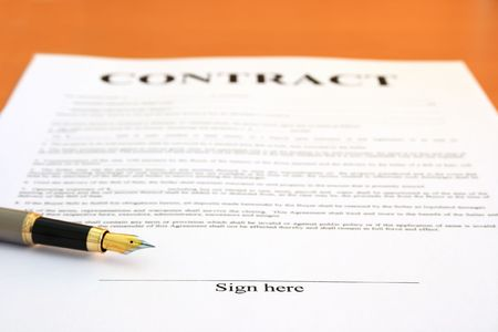 Contract document and fountain pen. Shallow depth of field, focus on Sign here text photo