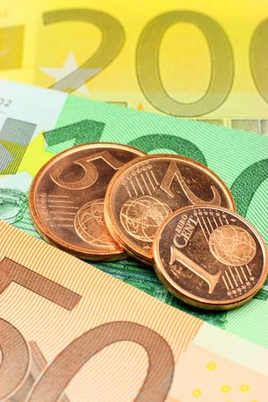 Euro notes and coins closeup. Shallow depth of field, focus on coins. Used coins. Stock Photo - 3131045