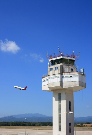 control tower: Airport control tower and airplane taking-off